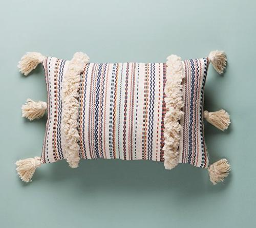 throw pillow tasseled tufted bed